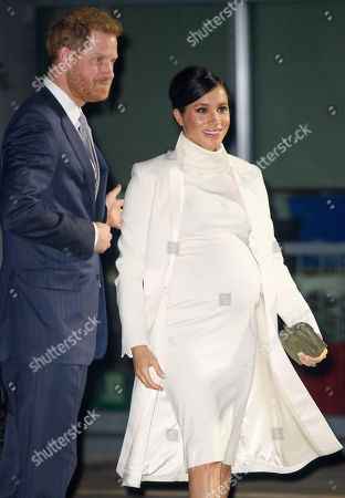 Prince Harry and Meghan Duchess of Sussex arrive at the Natural History Museum gala performance of 'The Wider Earth' in support of The Queen's Commonwealth Trust and The Queen's Commonwealth Canopy.