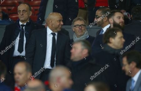 Former Paris Saint Germain coach Laurent Blanc, centre, arrives to watch the Champions League round of 16 soccer match between Manchester United and Paris Saint Germain at Old Trafford stadium in Manchester, England