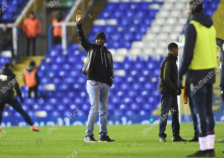 Former Birmingham City and Bolton Wanderers player Fabrice Muamba waves to the crowd at half time