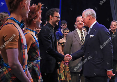 Prince Charles shakes hands with choreographer Liam Scarlett as he attends the world premiere of the ballet, The Cunning Little Vixen, in honour of his 70th birthday at the Royal Opera House, London.