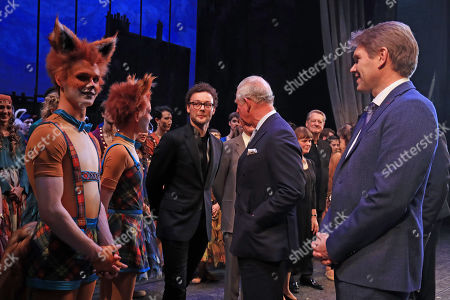 Stock Photo of Prince Charles meets cast members and choreographer Liam Scarlett (centre) as he attends the world premiere of the ballet, The Cunning Little Vixen, in honour of his 70th birthday at the Royal Opera House, London.