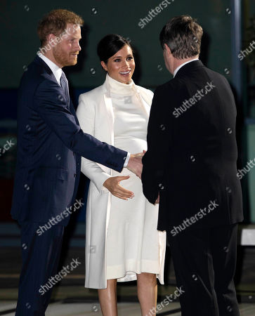 Meghan Duchess of Sussex arrives with Prince Harry for the gala performance of 'The Wider Earth'