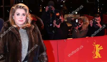 Catherine Deneuve (R) and French director Andre Techine (L) arrive for the premiere of 'Farewell to the night' (L'Adieu a la nuit) during the 69th annual Berlin Film Festival, in Berlin, Germany, 12 February 2019. The movie is presented in the Official Competition at the Berlinale that runs from 07 to 17 February.