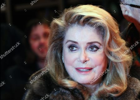 Catherine Deneuve (L) and French director Andre Techine (R) arrive for the premiere of 'Farewell to the night' (L'Adieu a la nuit) during the 69th annual Berlin Film Festival, in Berlin, Germany, 12 February 2019. The movie is presented in the Official Competition at the Berlinale that runs from 07 to 17 February.