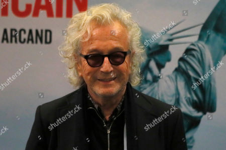 Stock Picture of Canadian composer Luc Plamondon poses during a photocall for the French premiere of the film 'The Fall of the American Empire' in Paris
