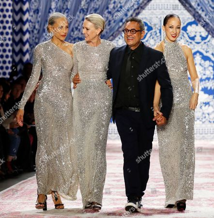 Models Alva Chinn, Karen Bjornson, and Pat Cleveland walk the runway with designer Naeem Khan after they modeled the gowns they are wearing during New York Fashion Week, in New York