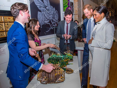 Being shown puppet animals by creators Nicholas Pain and David Morton - Prince Harry and Meghan Duchess of Sussex attend the gala performance of The Wider Earth in support of the Queen's Commonwealth Trust (QCT) and the production's official charitable partner, The Queen's Commonwealth Canopy (QCC).