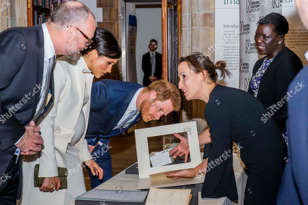 Seeing Darwins artefacts with NHM staff - Prince Harry and Meghan Duchess of Sussex attend the gala performance of The Wider Earth in support of the Queen's Commonwealth Trust (QCT) and the production's official charitable partner, The Queen's Commonwealth Canopy (QCC).