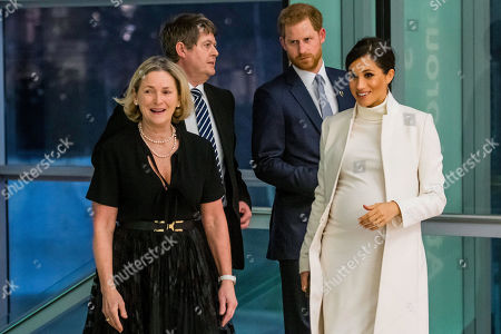 Being greeted by producer Trish Wadley and NHM director Mike Dixon - Prince Harry and Meghan Duchess of Sussex attend the gala performance of The Wider Earth in support of the Queen's Commonwealth Trust (QCT) and the production's official charitable partner, The Queen's Commonwealth Canopy (QCC).