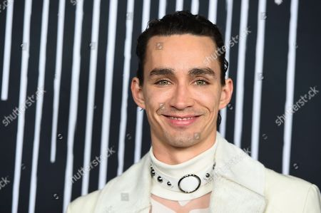 "Robert Sheehan arrives at the Los Angeles premiere of ""The Umbrella Company"" at The Arclight Hollywood on"