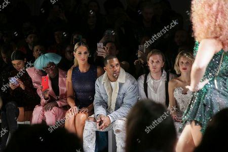 Carmen Carrera, Victor Cruz, Barron Hilton II, Tessa Hilton. Carmen Carrera, from left, Victor Cruz, Barron Hilton II and Tessa Hilton attend The Blonds Runway Show held at Spring Studios during New York Fashion Week on in New York