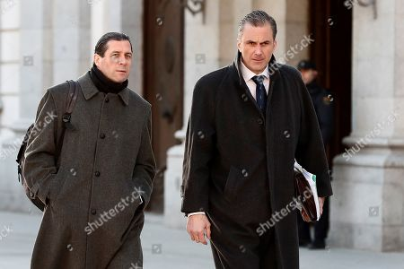 Stock Photo of Secretary General of the far right party Vox, Javier Ortega Smith (R), and the party's Judicial Secretary, Pedro Fernandez (L), arrive to the Supreme Court in Madrid, Spain, 13 February 2019, on the second day of the trial of the so-called 'proces' case against 12 Catalan pro-independence politicians involved in the illegal referendum held back in 2017. Nine of the 12 pro-independence leaders are accused of rebellion and embezzlement for their role in the Catalan illegal independence referendum back in 2017, while the other three accused face disobedience charges. More than 500 people have been called to declare, some of them former members of the Spanish Government such as former Prime Minister Mariano Rajoy.