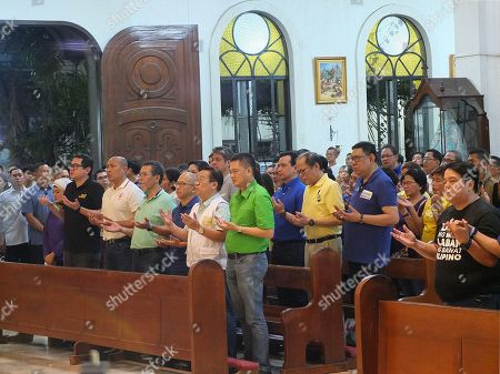 "The eight Senatorial candidates with former President Benigno ""Noynoy"" Aquino III seen joining hands in a celebrated mass in San Roque Cathedral in Caloocan City during the campaign."