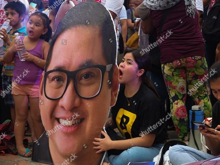 "Staunch supporters of Senator Paolo Benigno ""Bam"" Aquino IV, seen cheering with their huge printed face standee of the senator during the campaign."