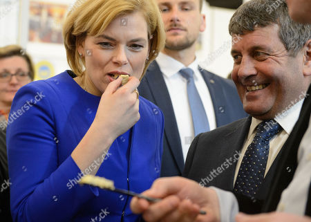 German Federal Minister for Food and Agriculture Julia Kloeckner(L) eats a piece of Irish cheese beside the Irish Minister of State for Food, Forestry and Horticulture Andrew Doyle at the 30th 'Biofach' trade fair in Nuremberg, Germany, 13 February 2019.  According to the organizer it's the world's largest trade fair for organic products and will run from 13 to 16 February 2019.