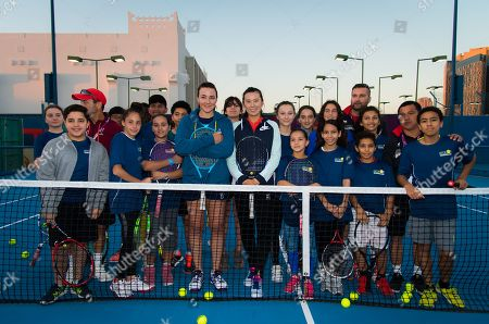Abigail Spears of the United States & Zhaoxuan Yang of China during a kids clinic at the 2019 Qatar Total Open WTA Premier tennis tournament