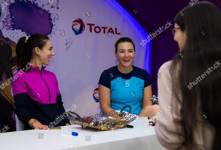 Mihaela Buzarnescu of Romania & Abigail Spears of the United States visit the Total Booth at the 2019 Qatar Total Open WTA Premier tennis tournament
