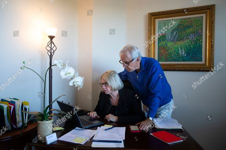 Debbie Douglas, Gary Douglas. Debbie Douglas works on her computer as her husband and business partner, Gary, watches in their home office in Newport Beach, Calif. In business together for 16 years, the Douglases have found that being co-owners of a public relations firm requires them to be more direct with each other than they once were as spouses