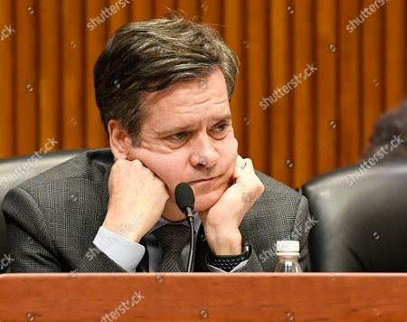 State Sen. Brad Hoylman, D-New York, listens as state legislators hold a public hearing on sexual harassment in the workplace, in Albany, N.Y