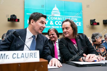Marcelo Claure (L), executive chairman of Sprint, and John Legere (R), CEO of T-Mobile, speak before testifying at a House Energy and Commerce Committee hearing on 'the state of competition in the wireless market' in the Rayburn House Office Building in Washington, DC, USA, 13 February 2019. Legere and Claure defended the proposed 26 billion US dollar merger between T-Mobile and Sprint.
