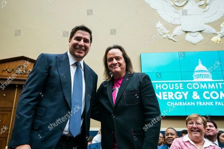 Marcelo Claure (L), executive chairman of Sprint, and John Legere (R), CEO of T-Mobile, pose for a picture before testifying at a House Energy and Commerce Committee hearing on 'the state of competition in the wireless market' in the Rayburn House Office Building in Washington, DC, USA, 13 February 2019. Legere and Claure defended the proposed 26 billion US dollar merger between T-Mobile and Sprint.