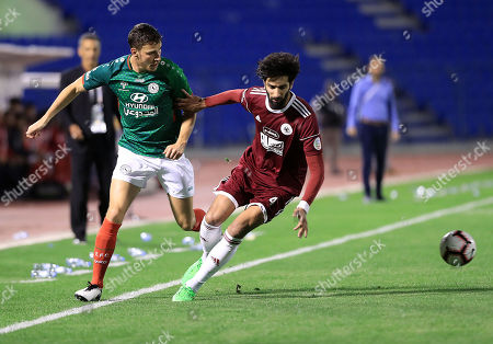 Al-Ettifaq player Fakhreddine Ben Youssef (L) in action for the ball with Al-Faisaly player Fahd Al-Ansari (R) during the Saudi Professional League soccer match between Al Ettifaq and Al-Faisaly at Prince Mohammed bin Fahd Stadium, Dammam, Saudi Arabia, 13 February 2019.