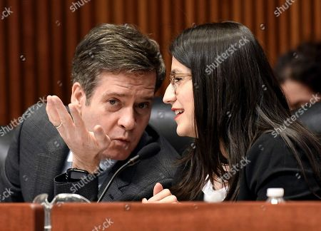 New York Sen. Brad Hoylman, D-New York, left, speaks with Sen. Jessica Ramos, D-East Elmhurst, as state legislators hold a public hearing on sexual harassment in the workplace, in Albany, N.Y