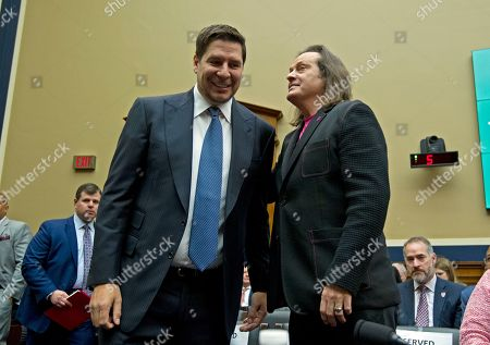 Sprint Corporation Executive Chairman Marcelo Claure, left, greets T-Mobile US CEO and President John Legere during the House Commerce subcommittee hearing on Capitol Hill in Washington
