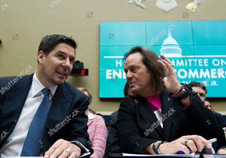 Sprint Corporation Executive Chairman Marcelo Claure, left, speaks with T-Mobile US CEO and President John Legere during the House Energy and Commerce subcommittee hearing on the T-Mobile and Sprint merger, at Capitol Hill in Washington