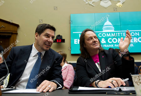 Sprint Corporation Executive Chairman Marcelo Claure, left, speaks with T-Mobile US CEO and President John Legere during the House Energy and Commerce subcommittee hearing on T-Mobile / Sprint merger, at Capitol Hill in Washington