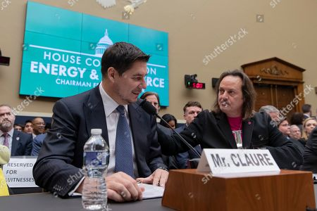 T-Mobile CEO John Legere, right, embraces Sprint CEO Marcelo Claure prior to their testimony before the House Energy and Commerce committee on Capitol Hill.