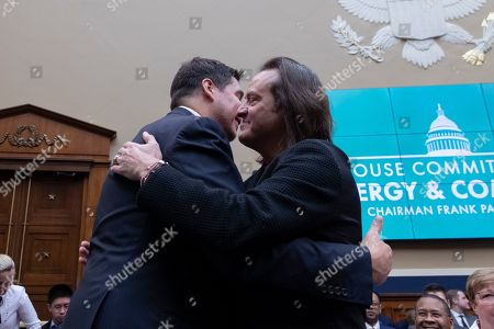 T-Mobile CEO John Legere, right, hugs Sprint CEO Marcelo Claure prior to their before the House Energy and Commerce committee on Capitol Hill.