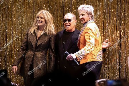 Patti Hansen, Michael Kors, Barry Manilow. Designer Michael Kors, center, is joined by model Patti Hansen and Barry Manilow on stage after his collection was modeled during Fashion Week in New York