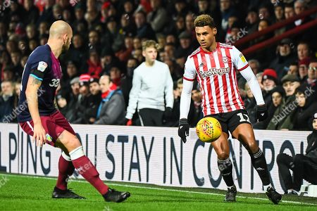 Brentford Forward Oliver Watkins (11) and Aston Villa Defender Alan Hutton (21) in action during the EFL Sky Bet Championship match between Brentford and Aston Villa at Griffin Park, London