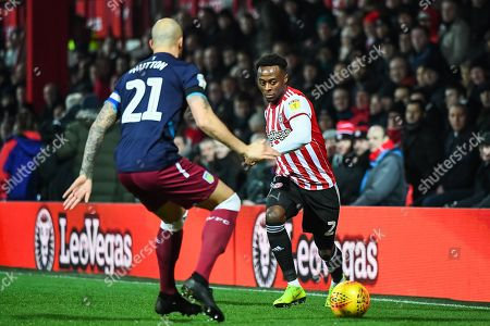 Brentford Midfielder Moses Odubajo (2) and Aston Villa Defender Alan Hutton (21) during the EFL Sky Bet Championship match between Brentford and Aston Villa at Griffin Park, London