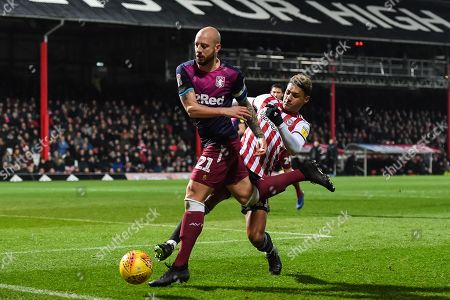 Aston Villa Defender Alan Hutton (21) and Brentford Forward Oliver Watkins (11) during the EFL Sky Bet Championship match between Brentford and Aston Villa at Griffin Park, London