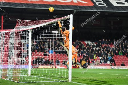 Aston Villa Goalkeeper Lovre Kalinic (28) tips the ball over the goal during the EFL Sky Bet Championship match between Brentford and Aston Villa at Griffin Park, London