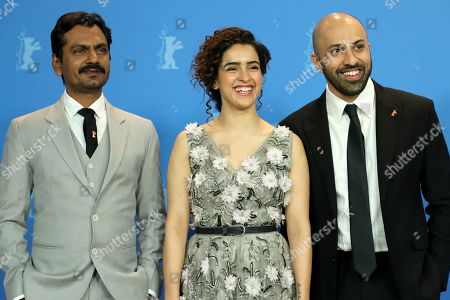 Ritesh Batra, Indian actress Sanya Malhotra (C) and Indian actor Nawazuddin Siddiqui pose during a photocall during the 69th annual Berlin Film Festival, in Berlin, Germany, 13 February 2019. The movie is presented in the Berlinale Especial at the Berlinale that runs from 07 to 17 February.