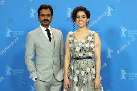 Indian actress Sanya Malhotra (R) and Indian actor Nawazuddin Siddiqui pose during a photocall during the 69th annual Berlin Film Festival, in Berlin, Germany, 13 February 2019. The movie is presented in the Berlinale Especial at the Berlinale that runs from 07 to 17 February.