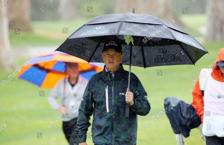 Stock Photo of Davis Love III walks to the 11th green in the Pro-Am round of the Genesis Open golf tournament at Riviera Country Club in the Pacific Palisades area of Los Angeles