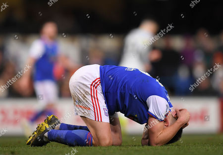 Jonas Knudsen of Ipswich Town holds his head after a collision