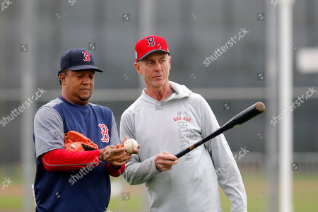 Former Boston Red Sox player Pedro Martinez, left, talks with Red Sox Latin American pitching advisor Goose Gregson, as pitchers and catchers report for their first workout at their baseball training facility in Ft. Myers, Fla