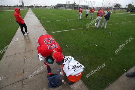 Boston Red Sox starting pitcher David Price (10) retrieves balls as pitchers and catchers report for their first workout at their spring training baseball facility in Ft. Myers, Fla