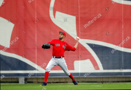 Boston Red Sox starting pitcher David Price warms up as pitchers and catchers reportde for their first workout at their spring training baseball facility in Ft. Myers, Fla