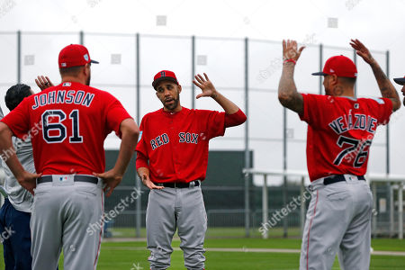 Boston Red Sox starting pitcher David Price, center, warms up with starting pitcher Brian Johnson (61) and starting pitcher Hector Velazquez (76), as pitchers and catchers report for their first workout at their spring training baseball facility in Ft. Myers, Fla