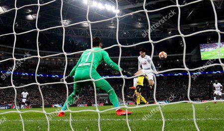 Son Heung-Min of Tottenham Hotspur  scores the opening goal  past Roman Burki of Borussia Dortmund