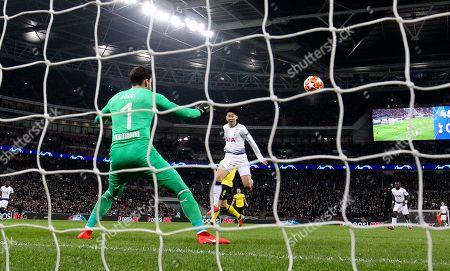 Stock Image of Son Heung-Min of Tottenham Hotspur  scores the opening goal  past Roman Burki of Borussia Dortmund