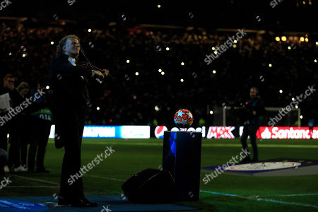Andre Rieu performs prior the first leg, round of sixteen, Champions League soccer match between Ajax and Real Madrid at the Johan Cruyff ArenA in Amsterdam, Netherlands