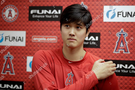 Los Angels Angels' Shohei Ohtani talks to the media at their spring baseball training facility in Tempe, Ariz., The AL Rookie of the Year is recovering from Tommy John surgery Oct. 1 with the idea he will be able to hit at some stage this year, perhaps as early as May if all stays on schedule