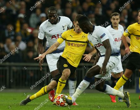 Christian Pulisic of Borussia Dortmund goes between Moussa Sissoko and Davinson Sanchez of Tottenham Hotspur during Tottenham Hotspur vs Borussia Dortmund, UEFA Champions League Football at Wembley Stadium on 13th February 2019